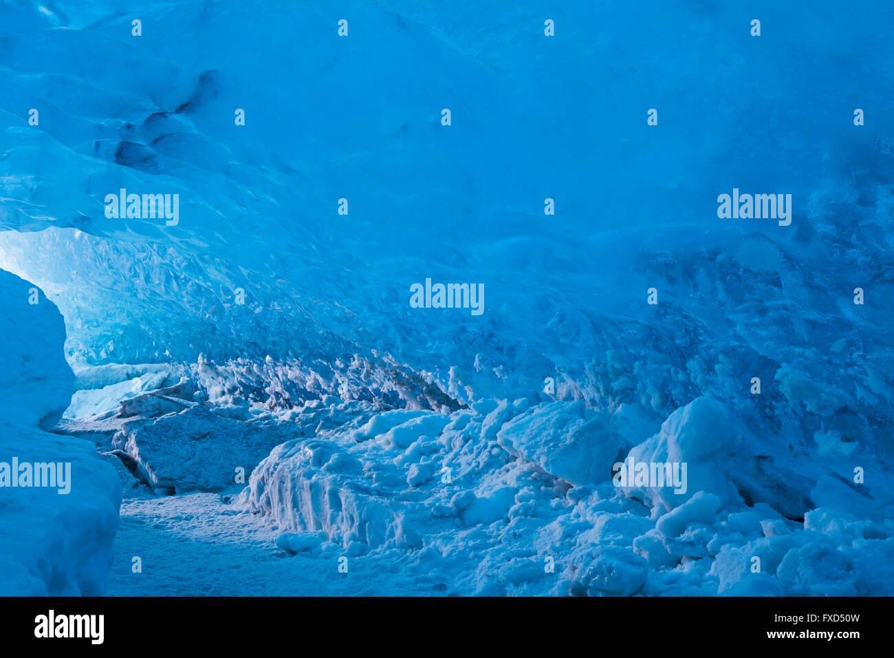 Blue ice in ice cavern inside Breidamerkurjokull, outlet glacier of Vatnajökull / Vatna Glacier on Iceland - Stock Image