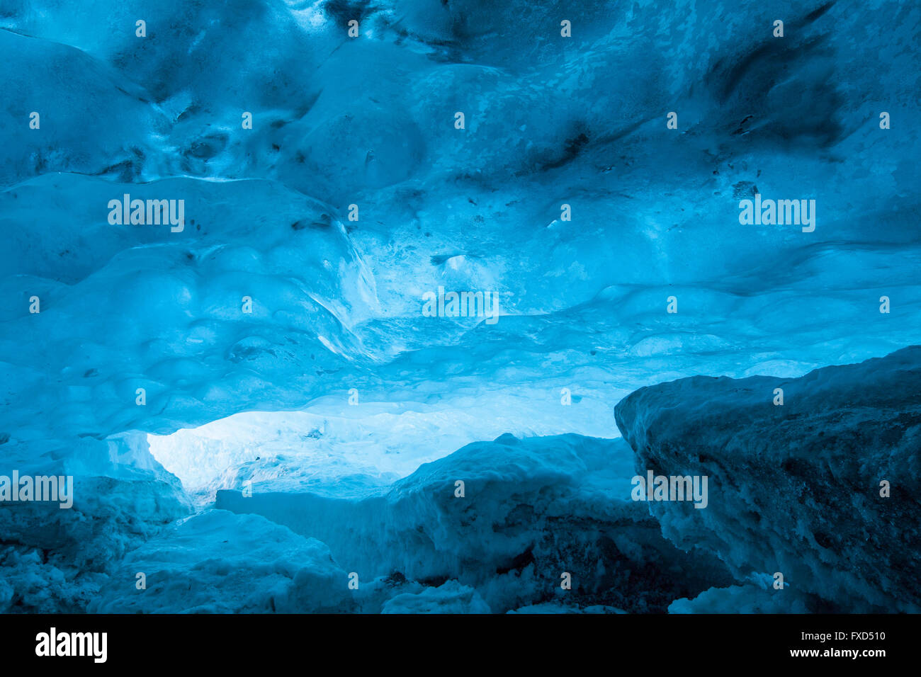 Blue ice mixed with volcanic ash in ice cavern inside Breidamerkurjokull, outlet glacier of Vatnajökull / Vatna - Stock Image