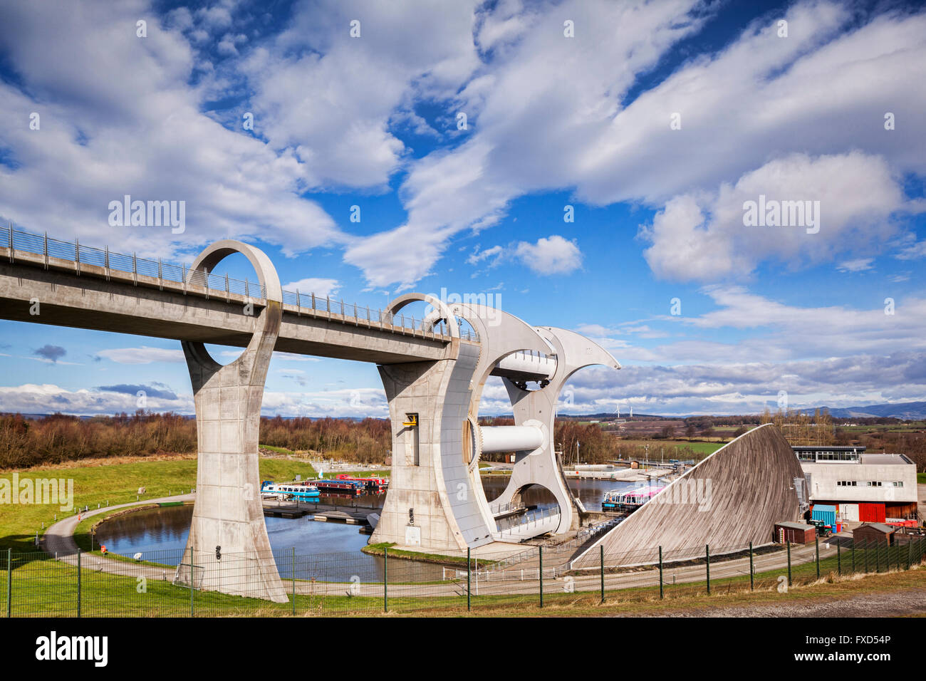 The high level approach to the Falkirk Wheel,  the rotating boat lift connecting the Forth and Clyde Canal with - Stock Image