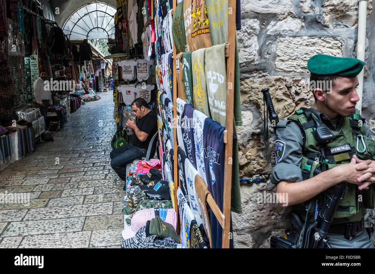 Israeli Border Police Magav on Arab market that sprawls across Christian and Moslem Quarters on Old City of Jerusalem, - Stock Image