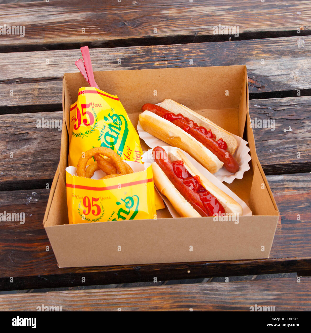 Hot Dogs With Fries And Onion Rings At Nathan S Hot Dog