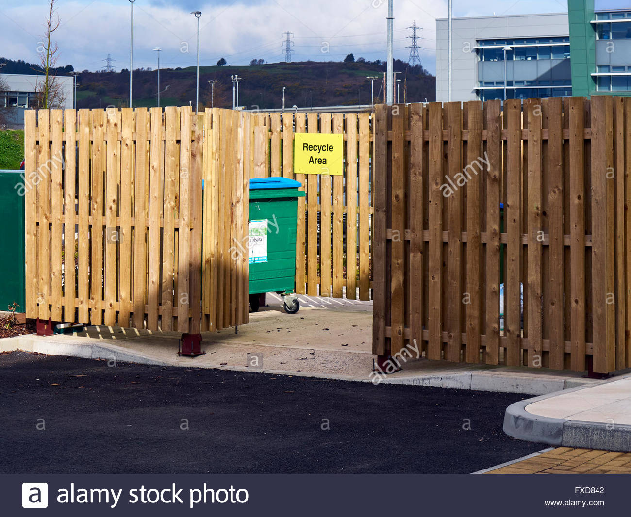 Wooden enclosure for storing recycling rubbish bins - Stock Image