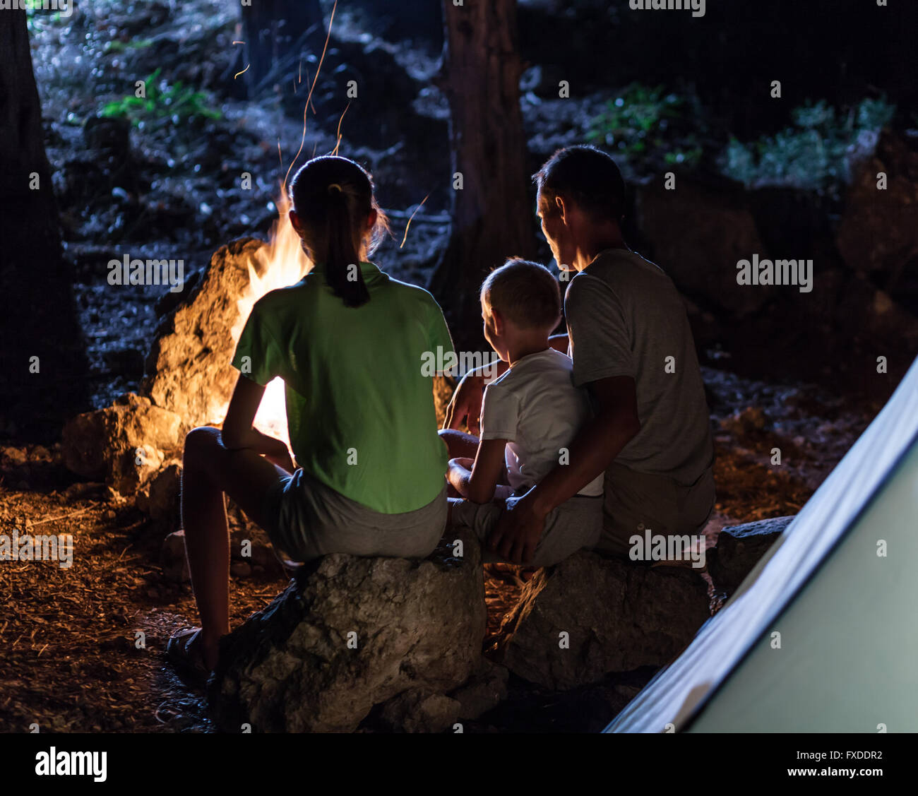 Family in the camping at night - Stock Image
