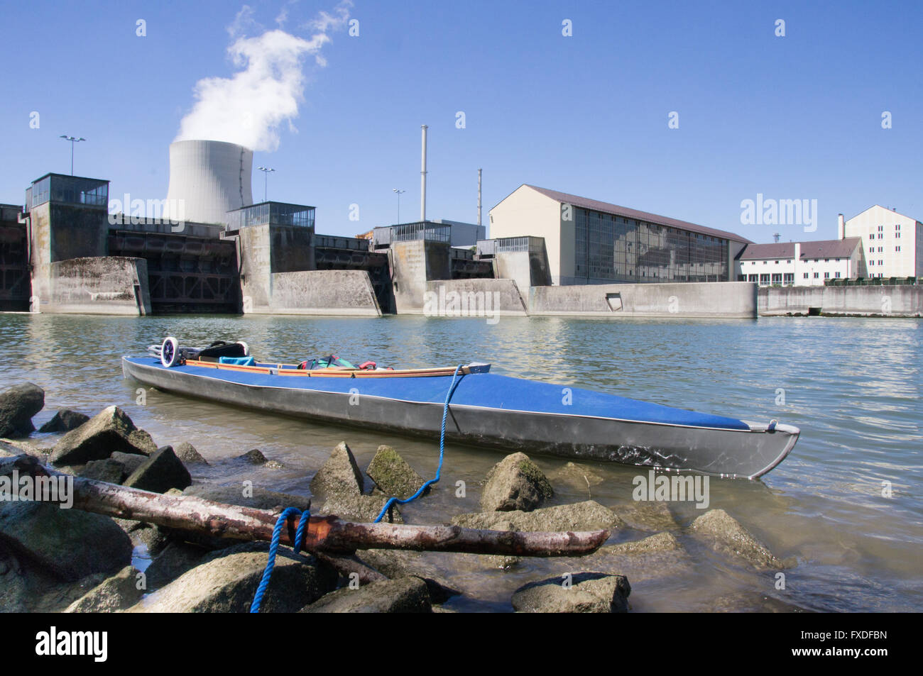 little folding boat in front of nuclear power plant - Stock Image