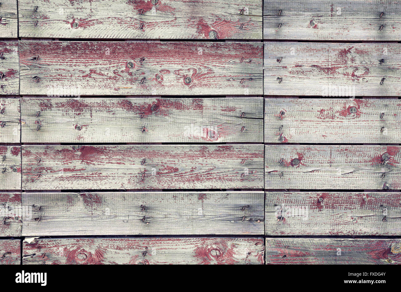 Old wooden planks texture with weathered red paint - Stock Image