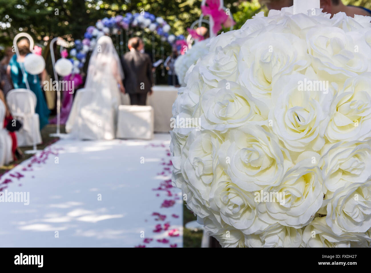 White Flower Ball Decoration For A Wedding Scene Stock Photo