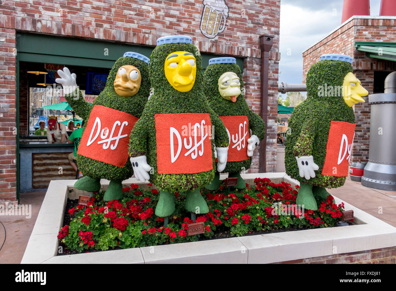 Life Size Statues Of Duff Beer Men From The Simpsons Cartoon TV Show At Universal Studios Florida - Stock Image