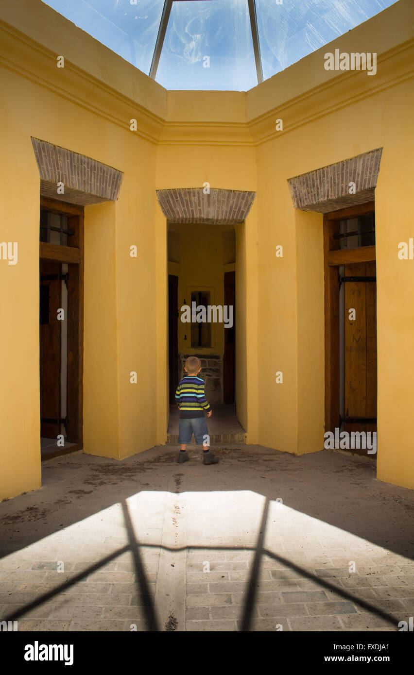 Historic Castle of Good Hope star fort circa 1700 in Cape Town South Africa with small boy in awe at entrance of - Stock Image