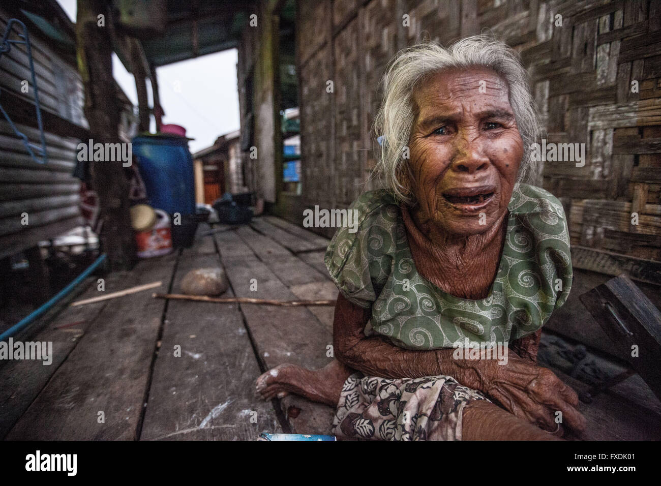 Burma, Myanmar, old woman, with wrinkled tanned skin and white hair. - Stock Image