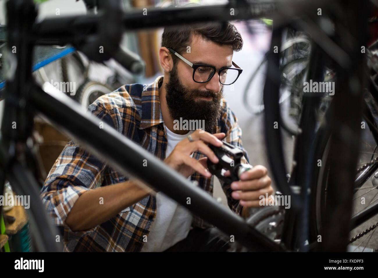 Bike mechanic checking at bicycle Stock Photo