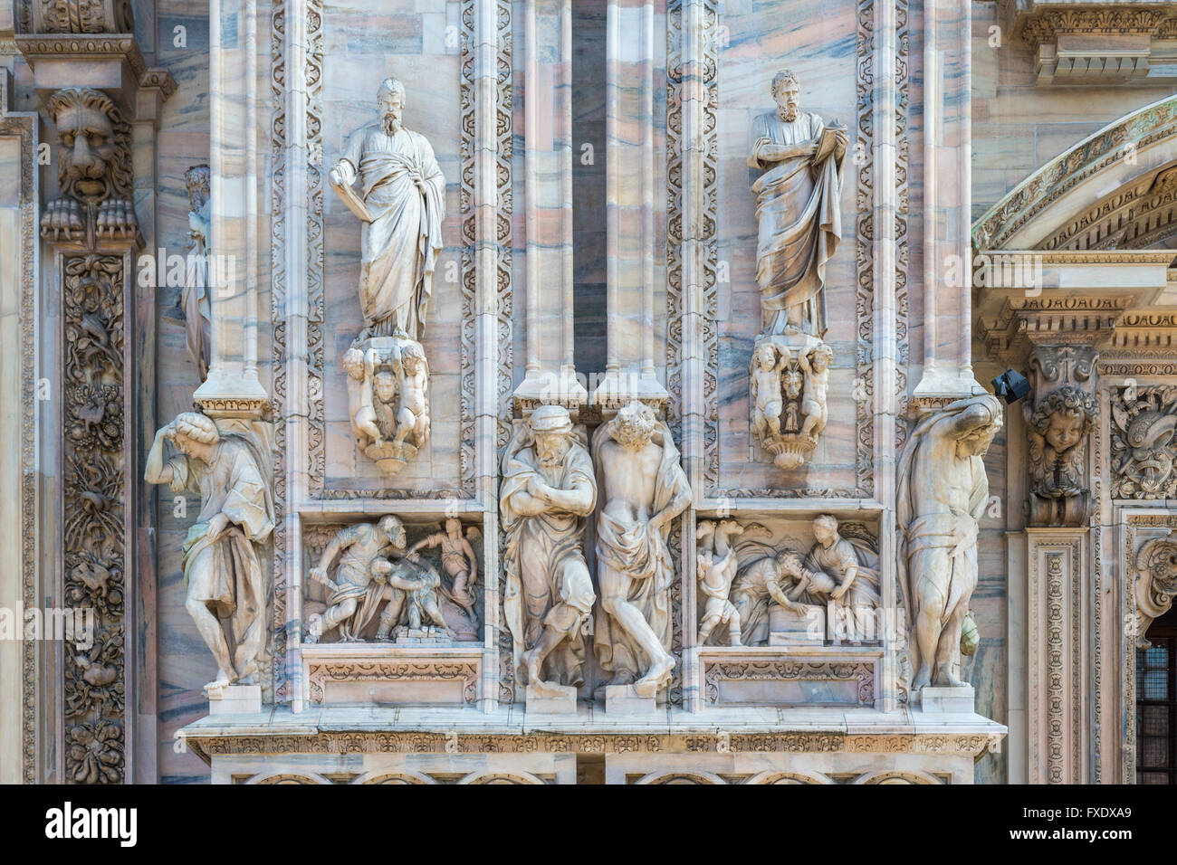 Sculptures on the marble facade, Milan Cathedral, Piazza del Duomo, Milan, Italy - Stock Image