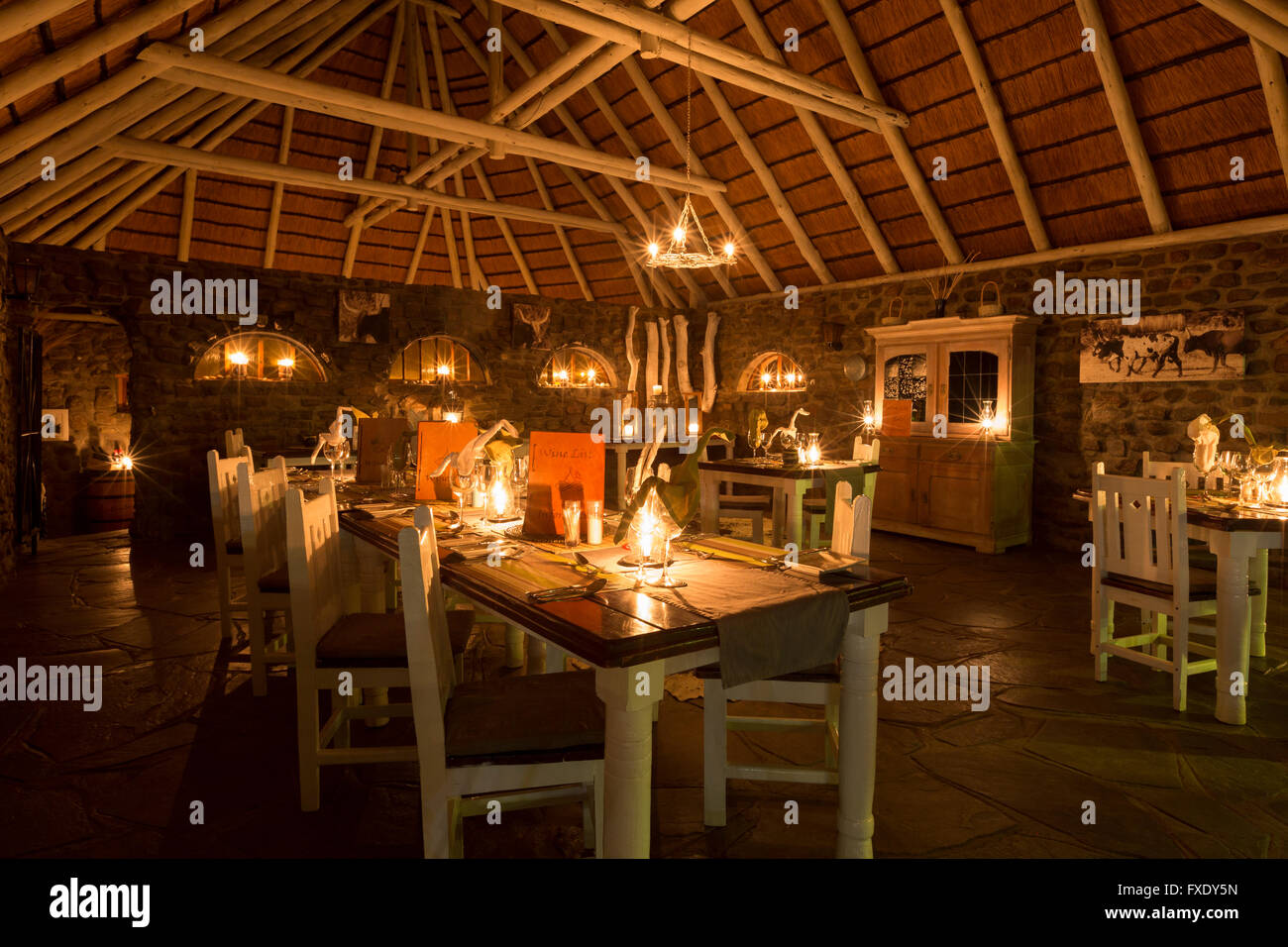 Laid tables in candlelight, Hotel The Elegant Farmstead, Okahandja, Namibia, Africa - Stock Image