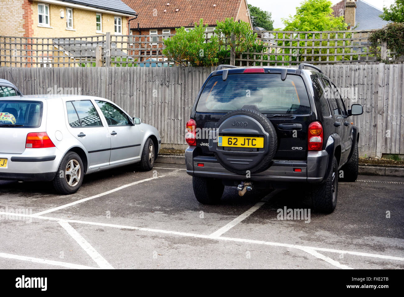 Inconsiderate parking in a car park, UK. THE SAME PICTURE WITHOUT NUMBER PLATE IS AVAILABLE. (See Image Ref: FXE2R7) - Stock Image