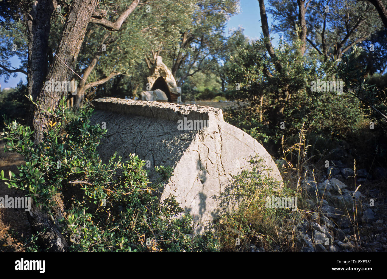 Plundered Lycian tomb in the hills of Kas, Antalya, Province, Turkey Stock Photo