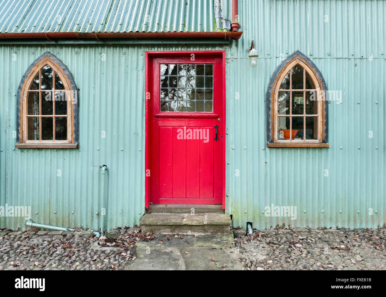 Muxton Chapel, Walcot Hall, Shropshire, UK. A Victorian corrugated iron chapel converted for use as a holiday cottage - Stock Image