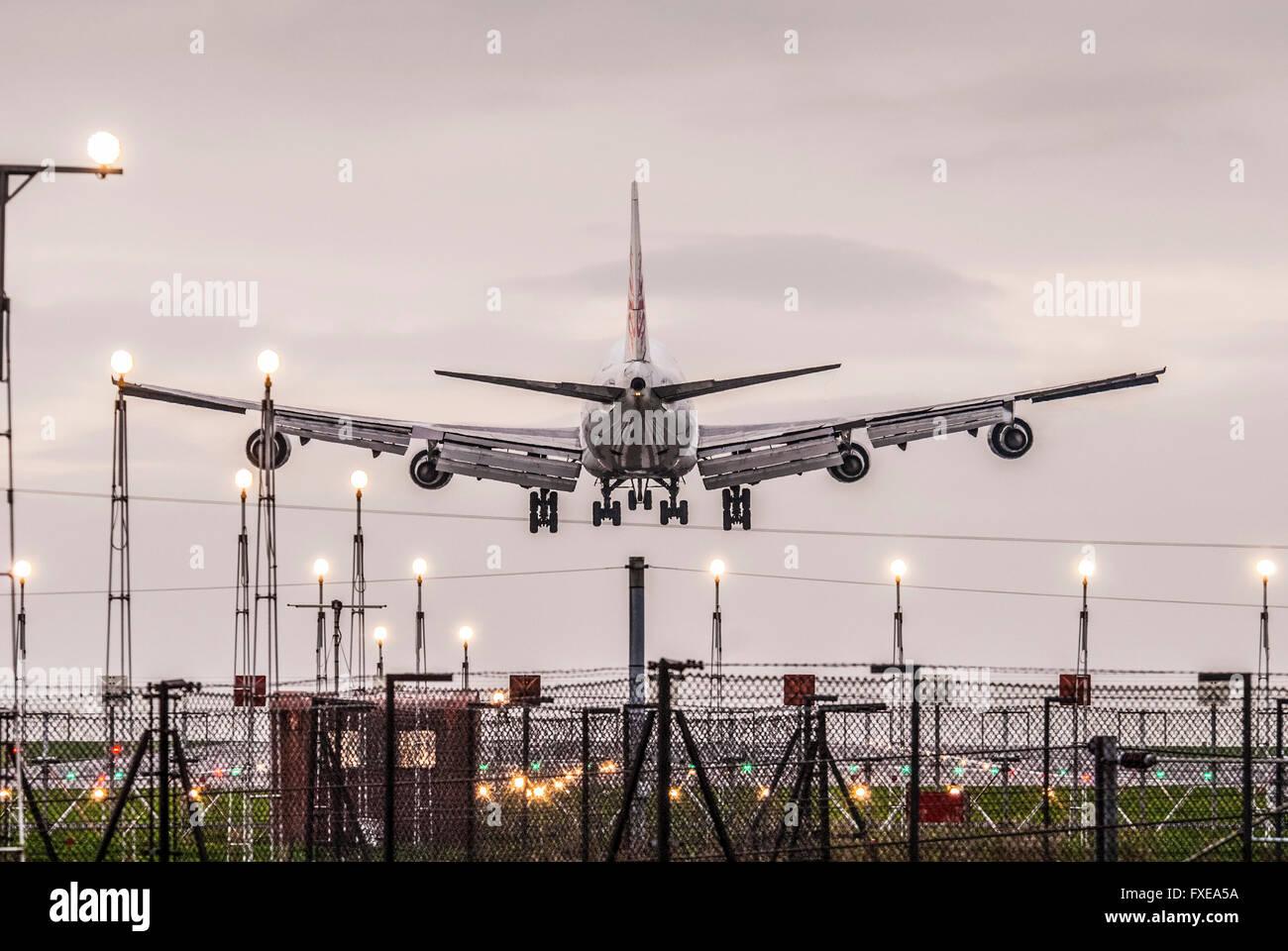 Boeing 747 jumbo jet landing. evening. - Stock Image