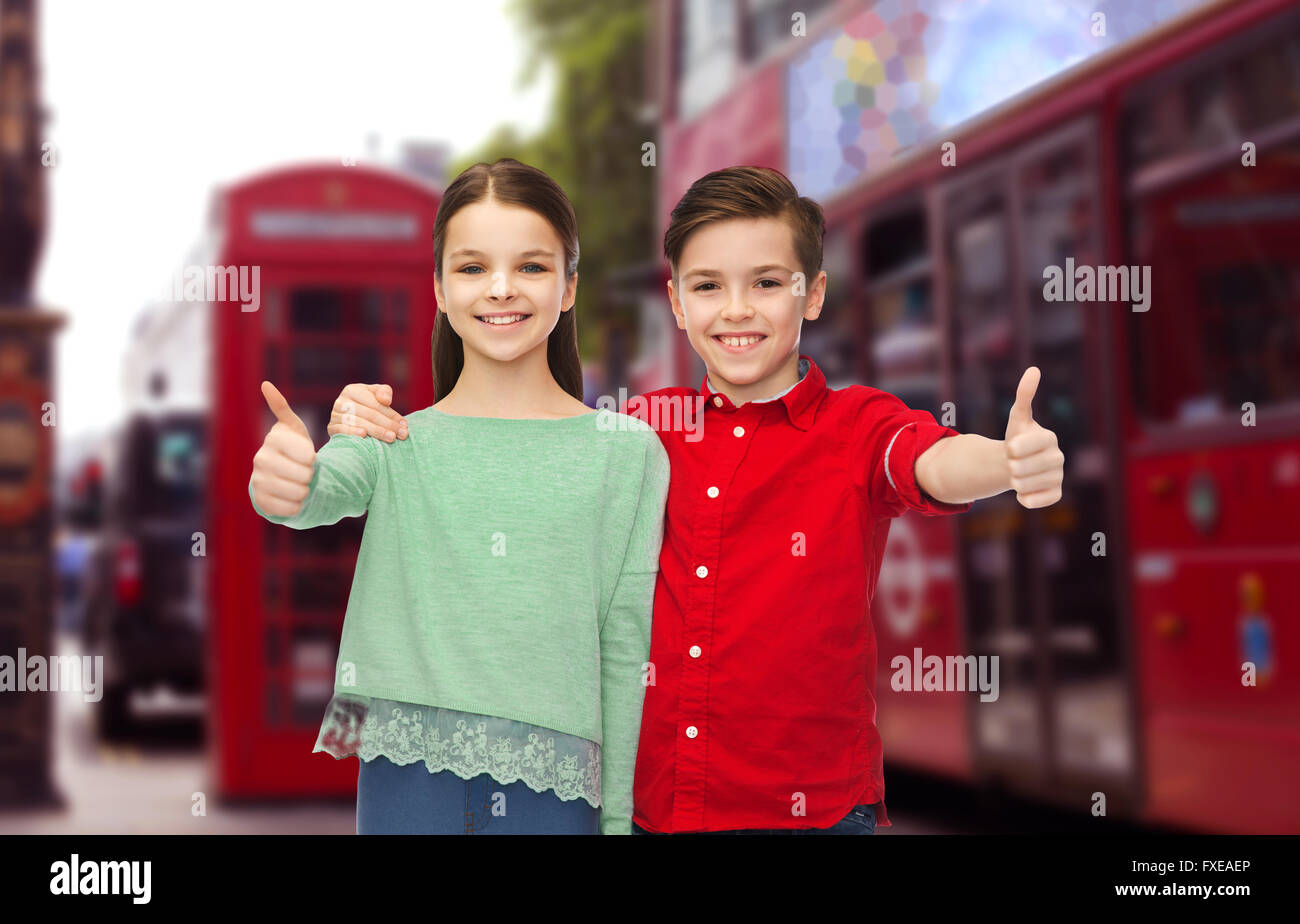 happy children showing thumbs up over london city - Stock Image