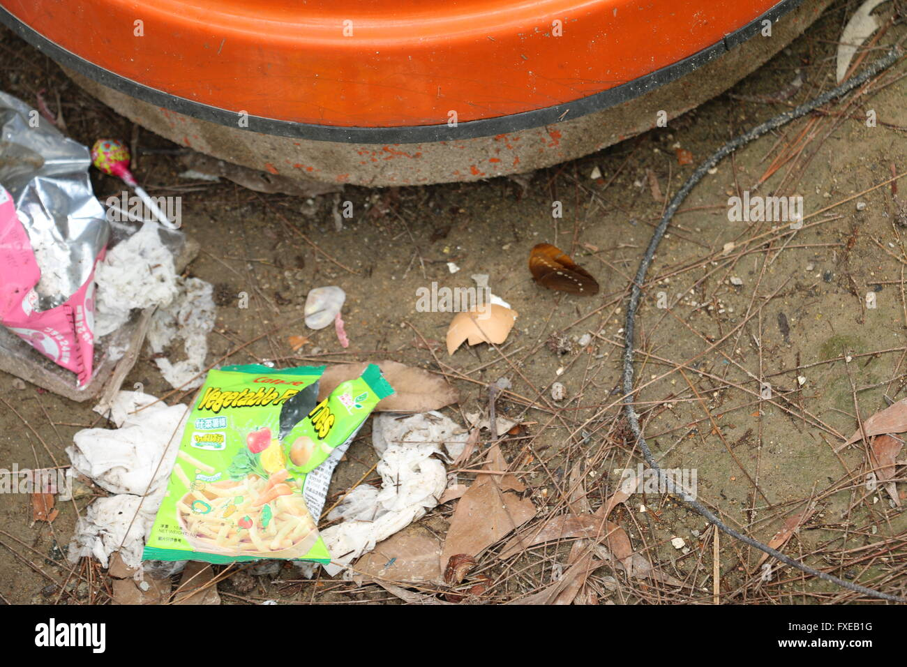 Garbage and a butterfly. - Stock Image