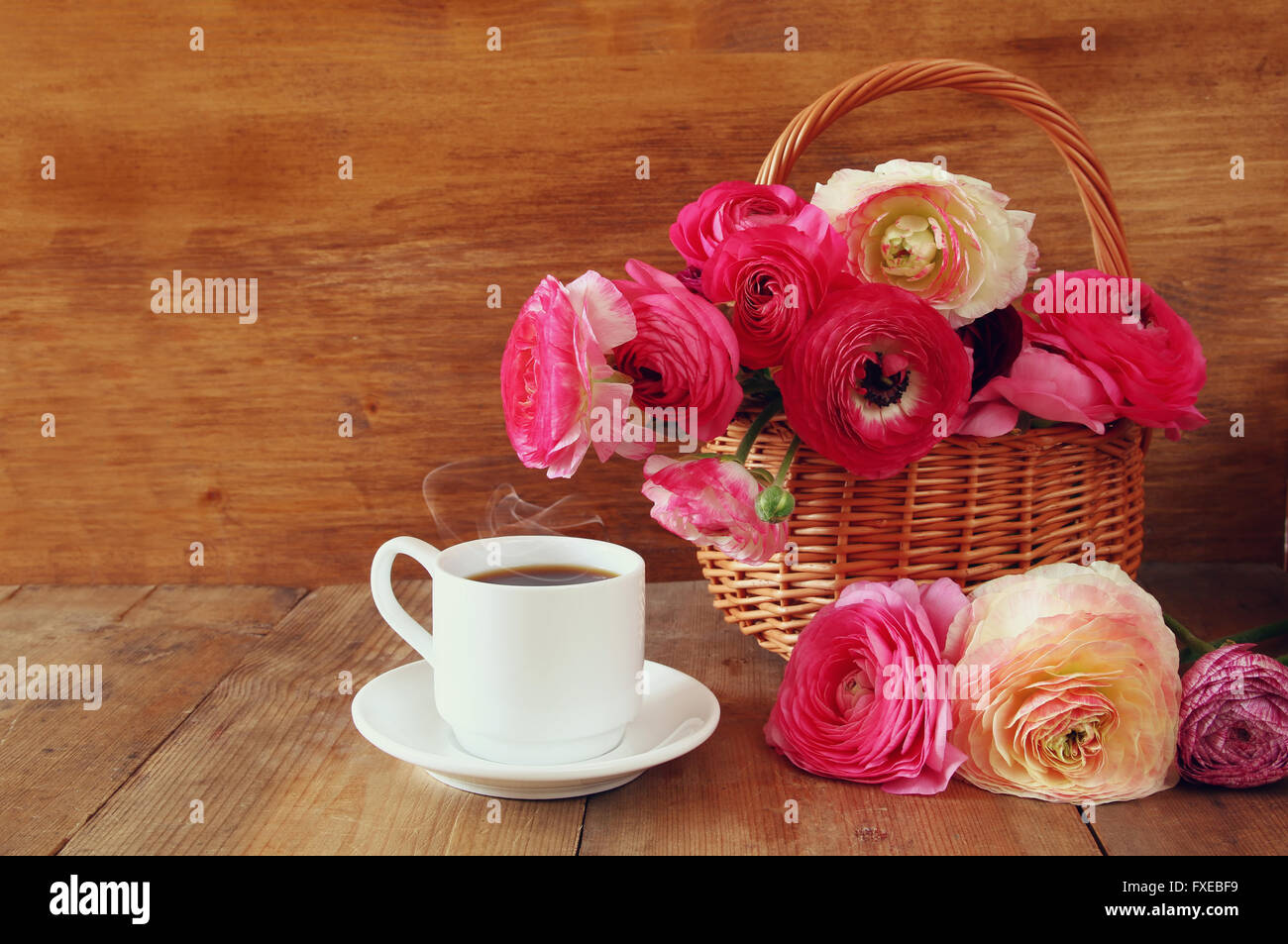 image of beautiful flowers next to cup of coffee. - Stock Image
