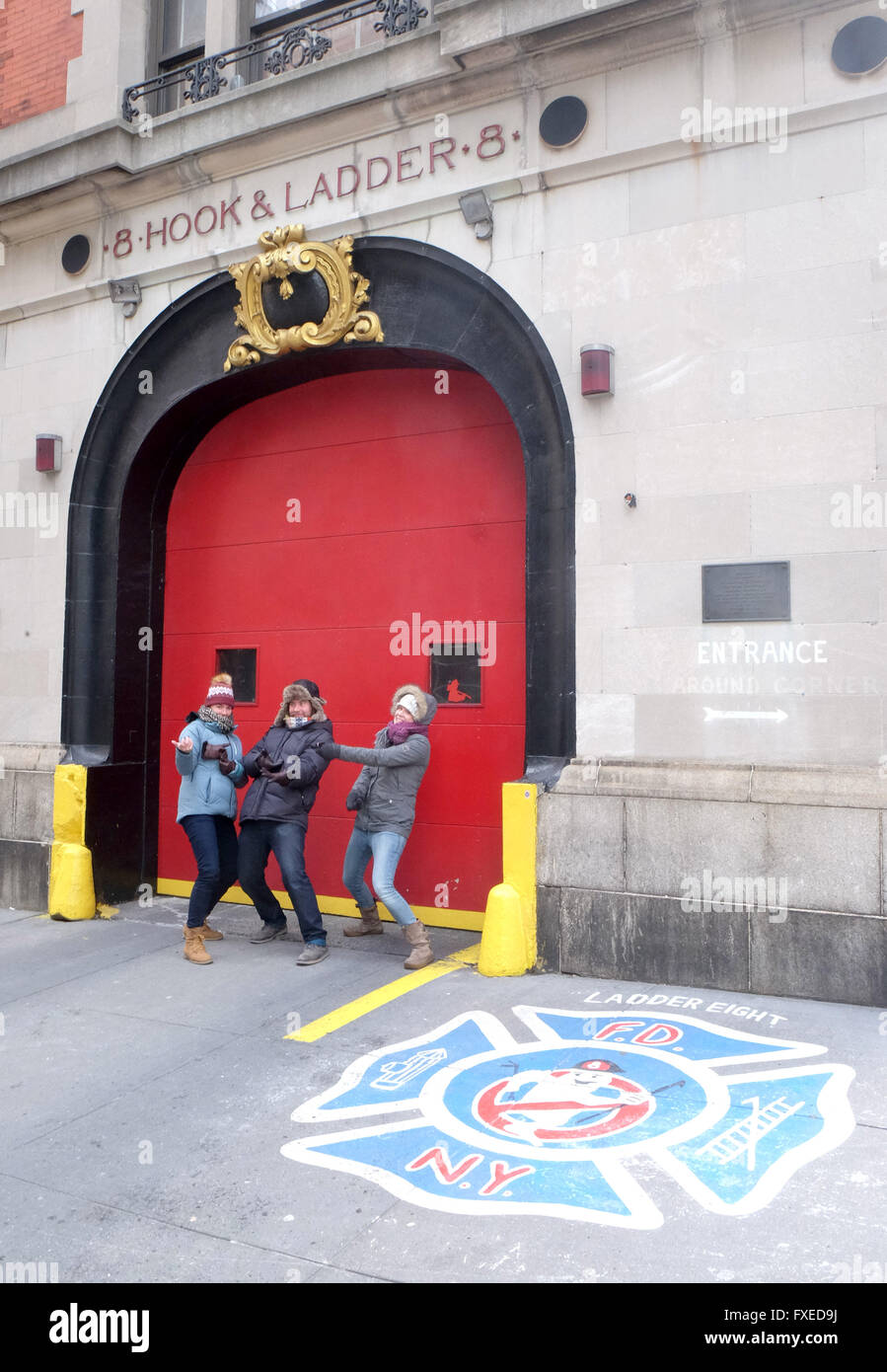 Tourists pose at the North Moore Street Fire Station made famous as a Ghostbusters film location in New York City, - Stock Image