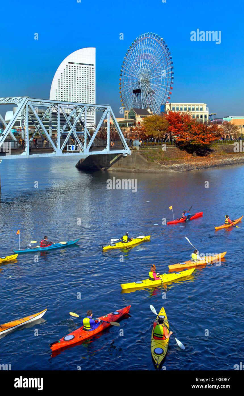 Canoeing group at canal Yokohama Japan - Stock Image