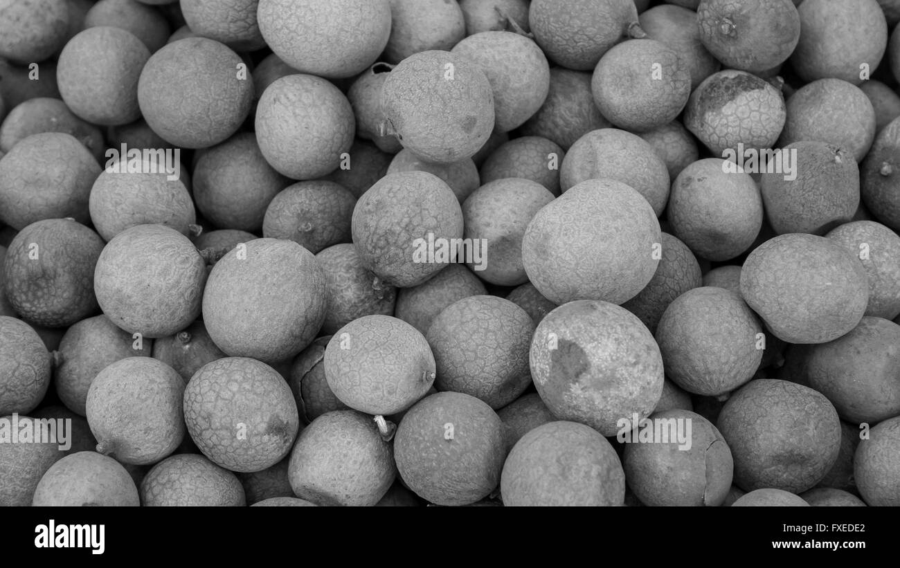 The close up of group of fresh longan at fruit market. (black and white tone) - Stock Image