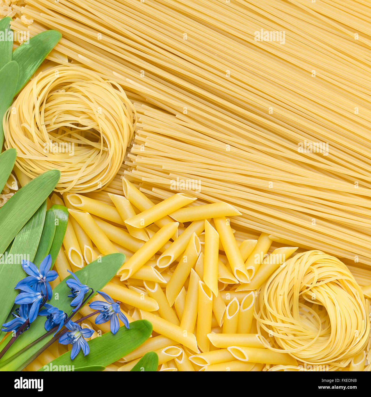 Different pasta lie on the surface. - Stock Image