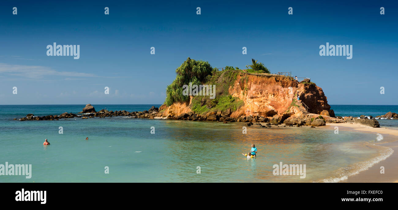 Sri Lanka, Mirissa, mother and daughter relaxing in sea on idyllic tropical beach at Parrot Rock Stock Photo