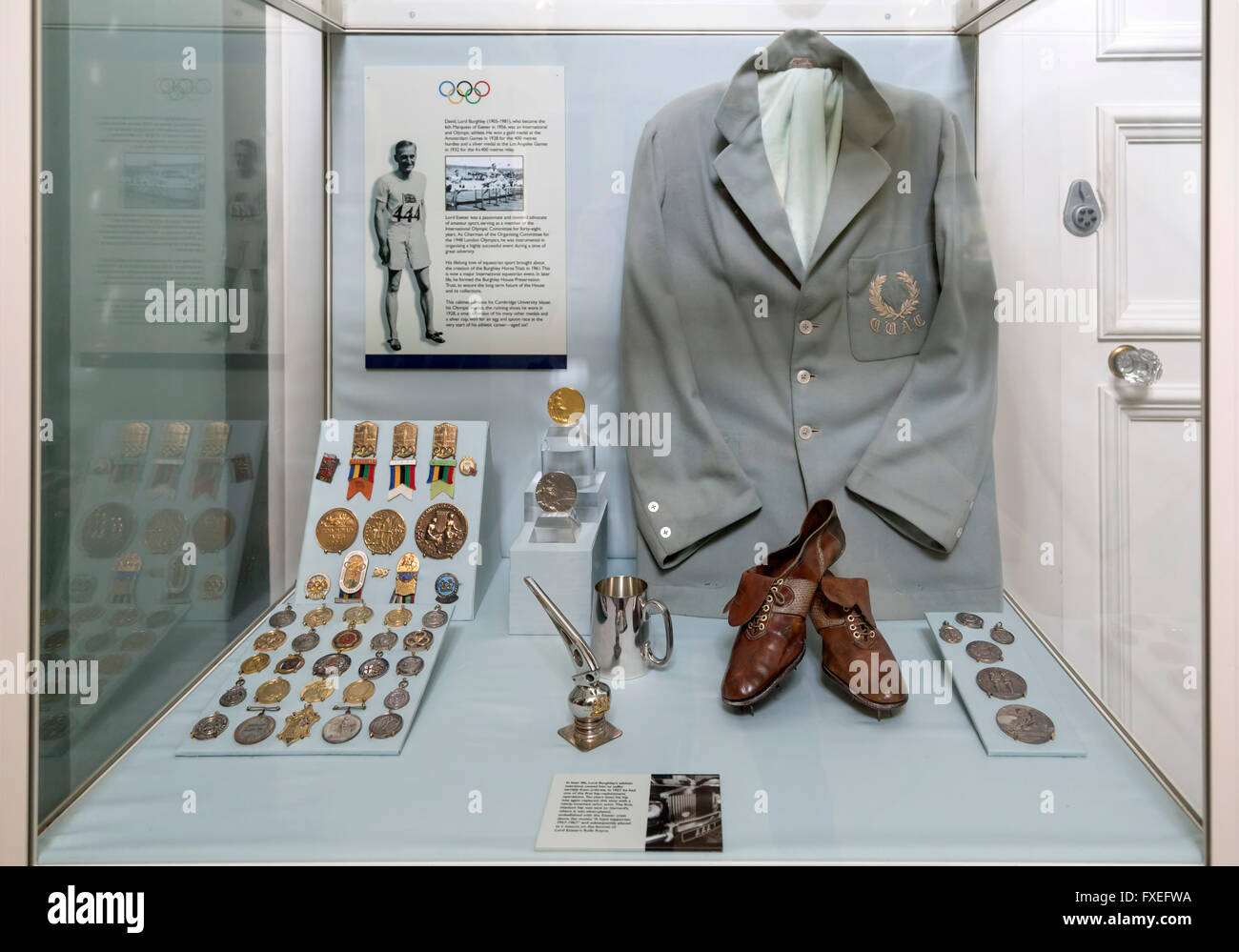 Glass case at Burghley House, showing David Burghley, who won the gold medal in the 400 m hurdles at the 1928 Summer - Stock Image