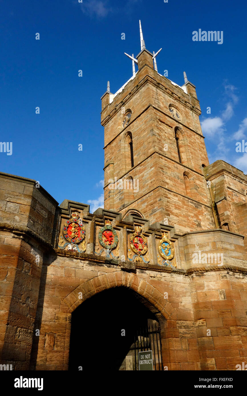 Outer gateway to Linlithgow Palace with the tower of the Church of St Michael, Linlithgow Stock Photo