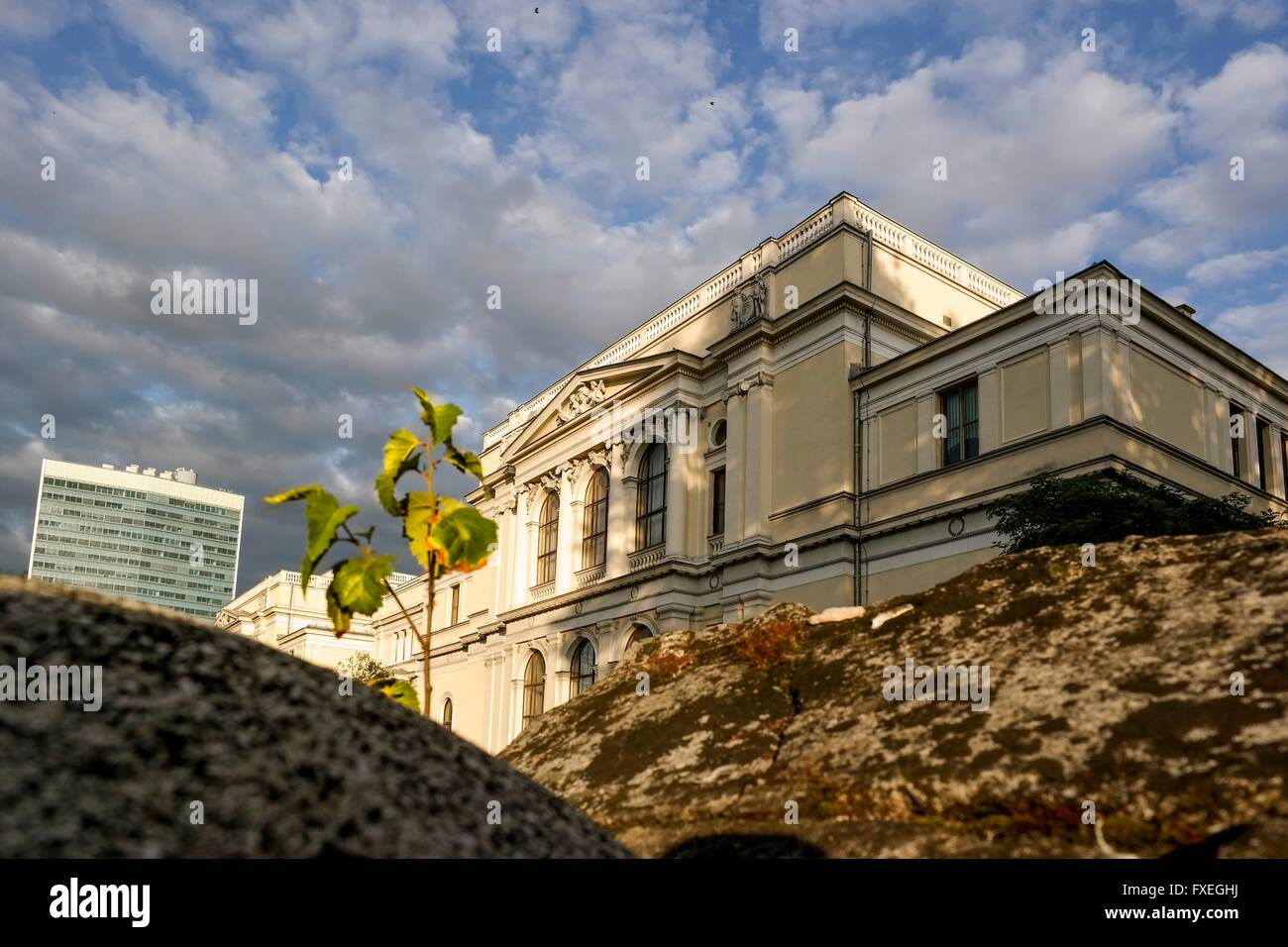 Old gravestone in front of the National Museum of Bosnia and Herzegovina and the Bosnian parliament. - Stock Image