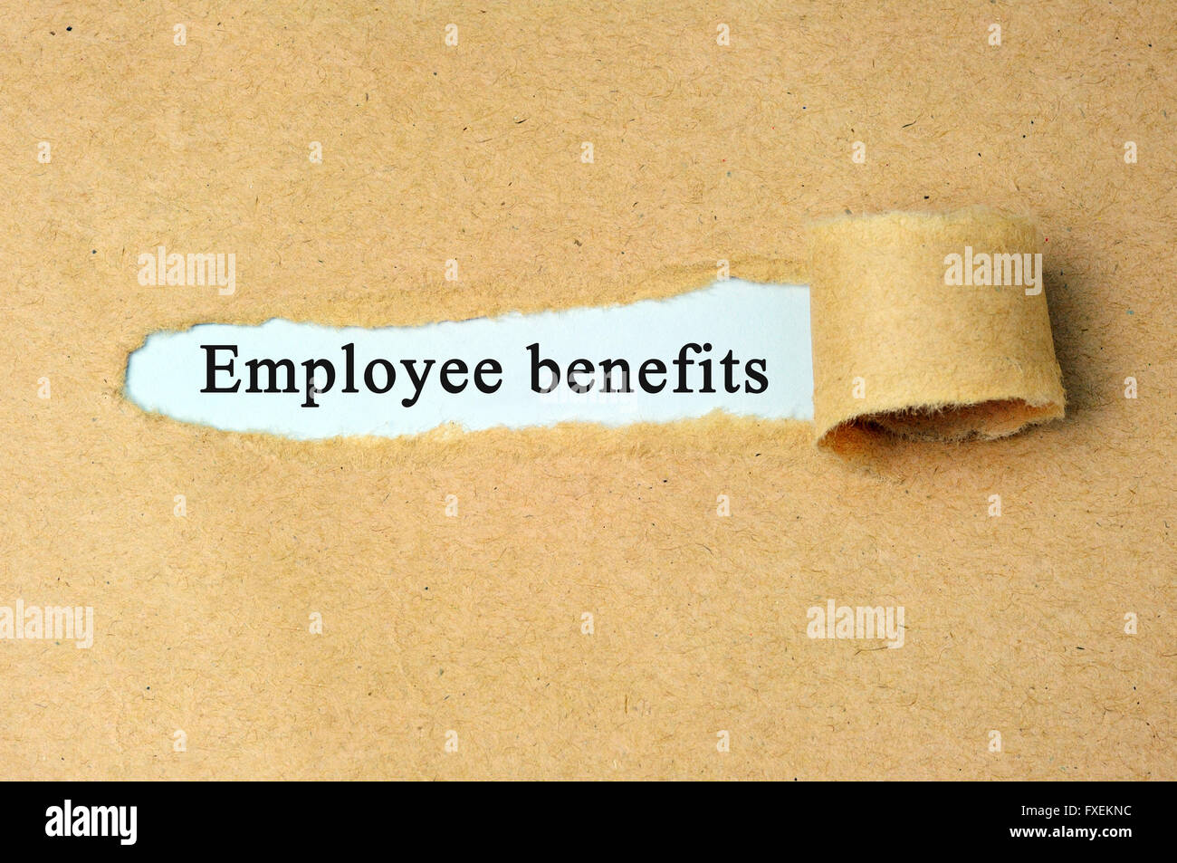 Ripped paper with  'Employee benefits' text. - Stock Image