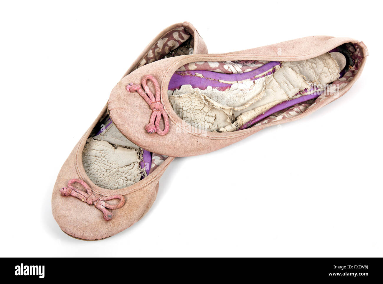 Pair of old well used  pink tattered female worn-out shoes - Stock Image