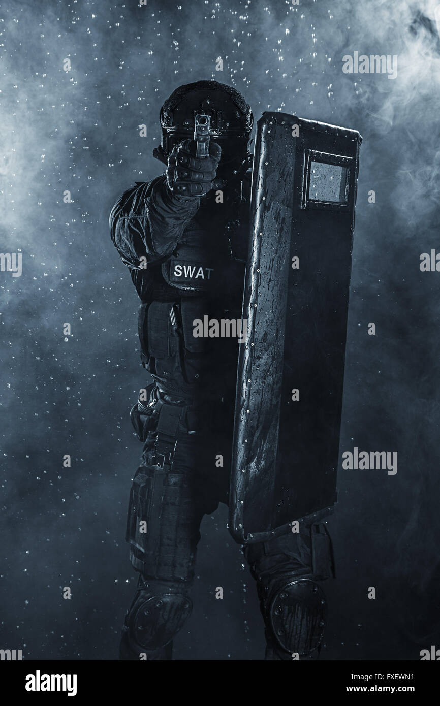 police officer with ballistic shield - Stock Image