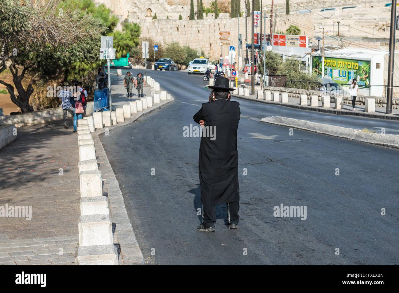 Orthodox Jew on Ma'ale HaShalom street called Pope's Road in Jerusalem, Israel - Stock Image
