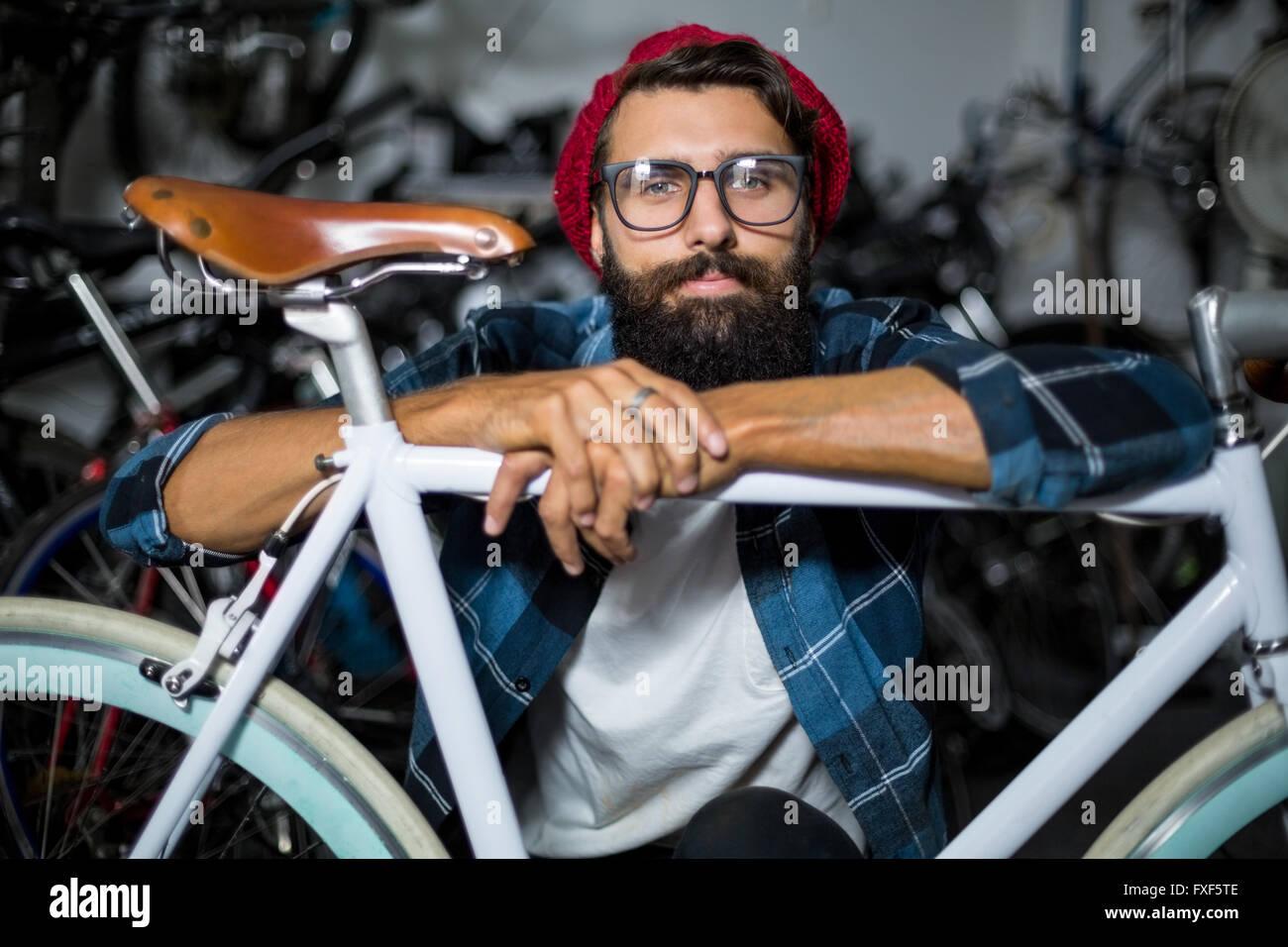 Bike mechanic checking at bicycle - Stock Image