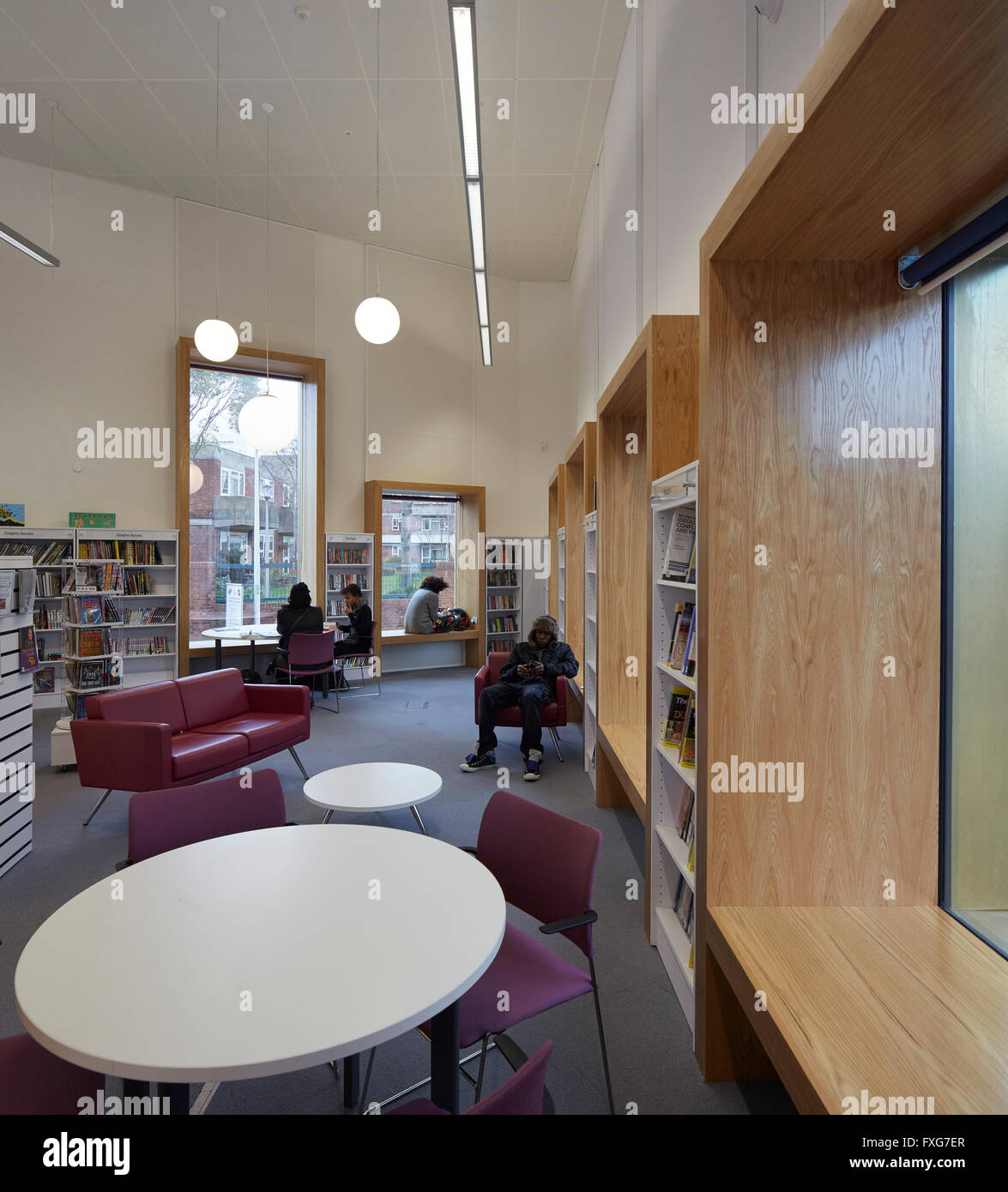 Interior view showing desks and recessed window seats. Camberwell Library, London, United Kingdom. Architect: John - Stock Image
