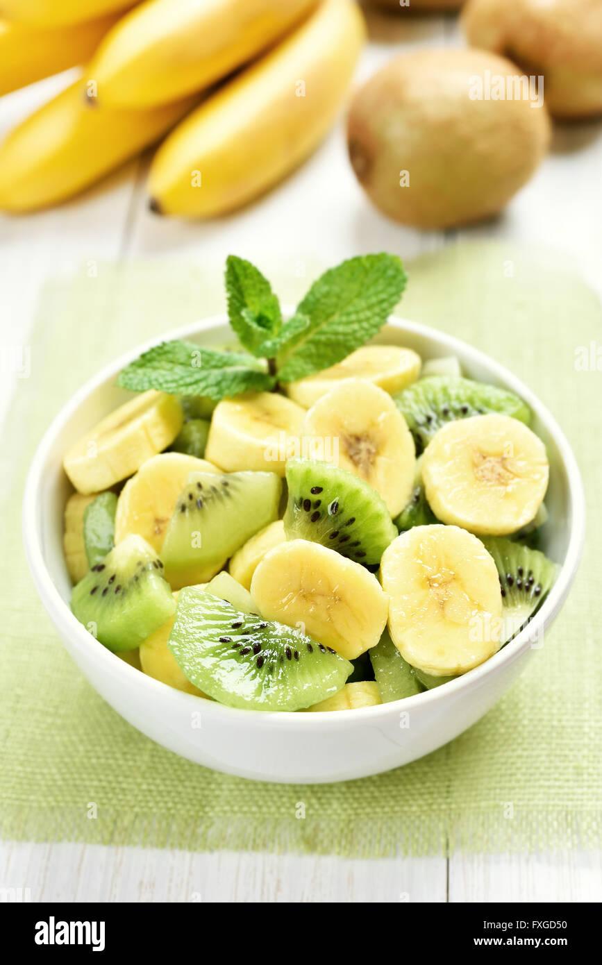 Breakfast fruit salad from kiwi and banana - Stock Image