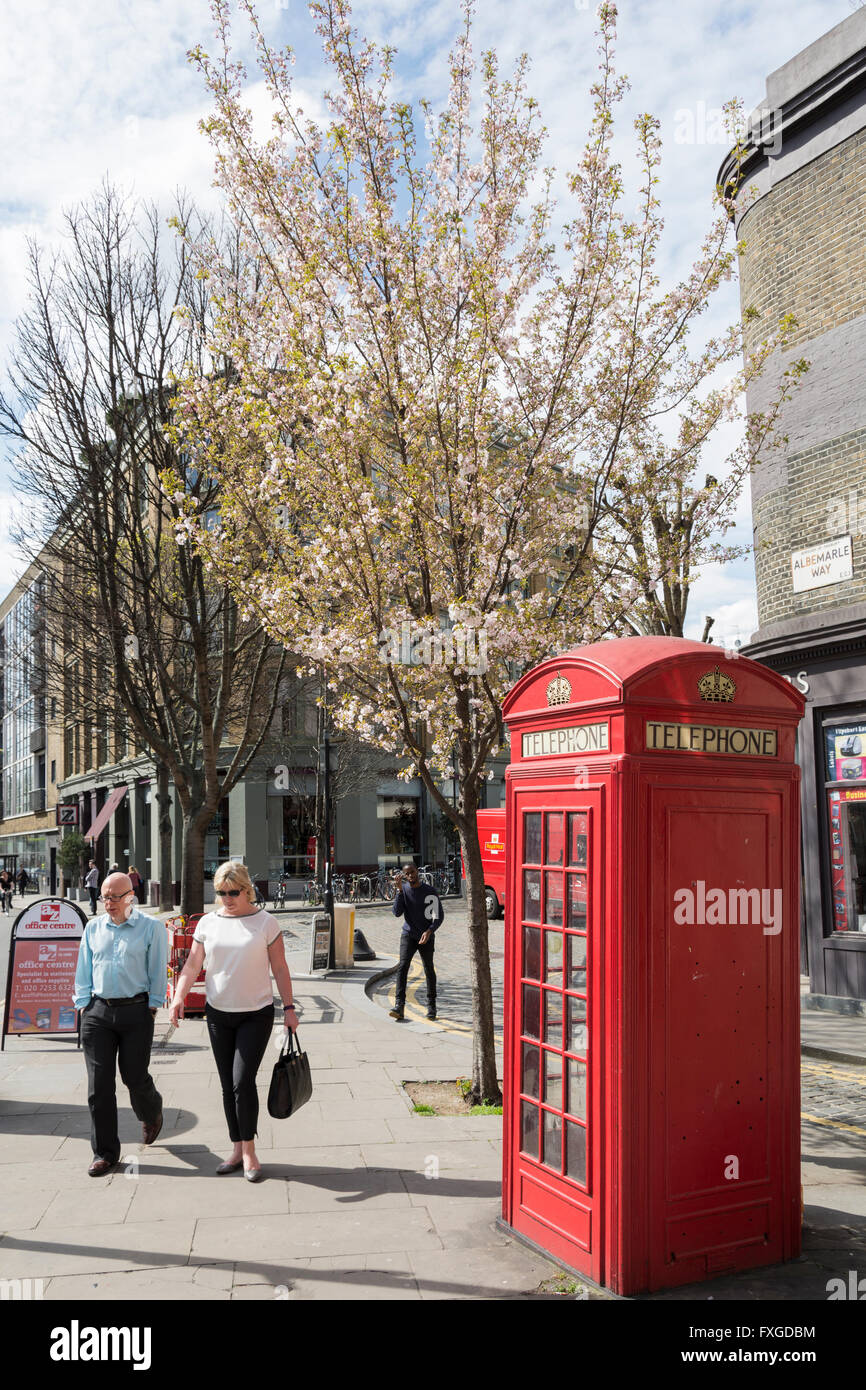 One of London's red telephone boxes, or kiosks, designed by Sir Giles Gilbert Scott, - Stock Image
