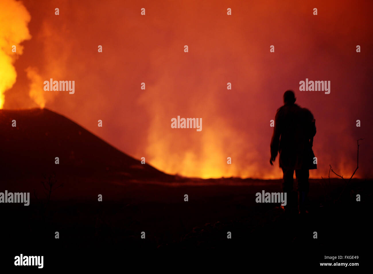 Rangers of the Virunga National Park in the Democratic Republic of Congo lead a tour to the newly erupting Nyamulagira - Stock Image