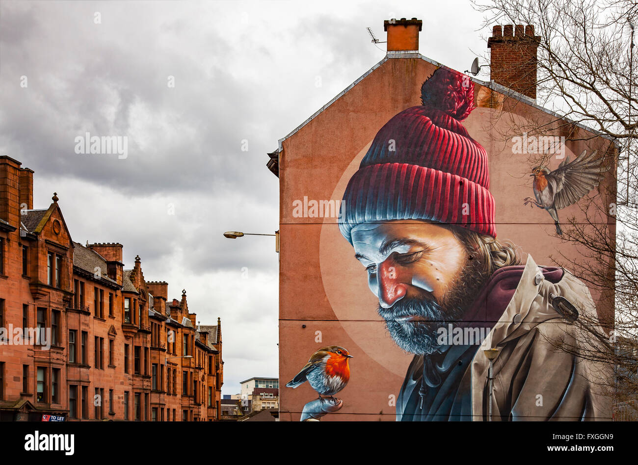 GLASGOW APRIL 02, 2016; Mural painting of a man with birds, on wall in central Galsgow, Scotland. - Stock Image