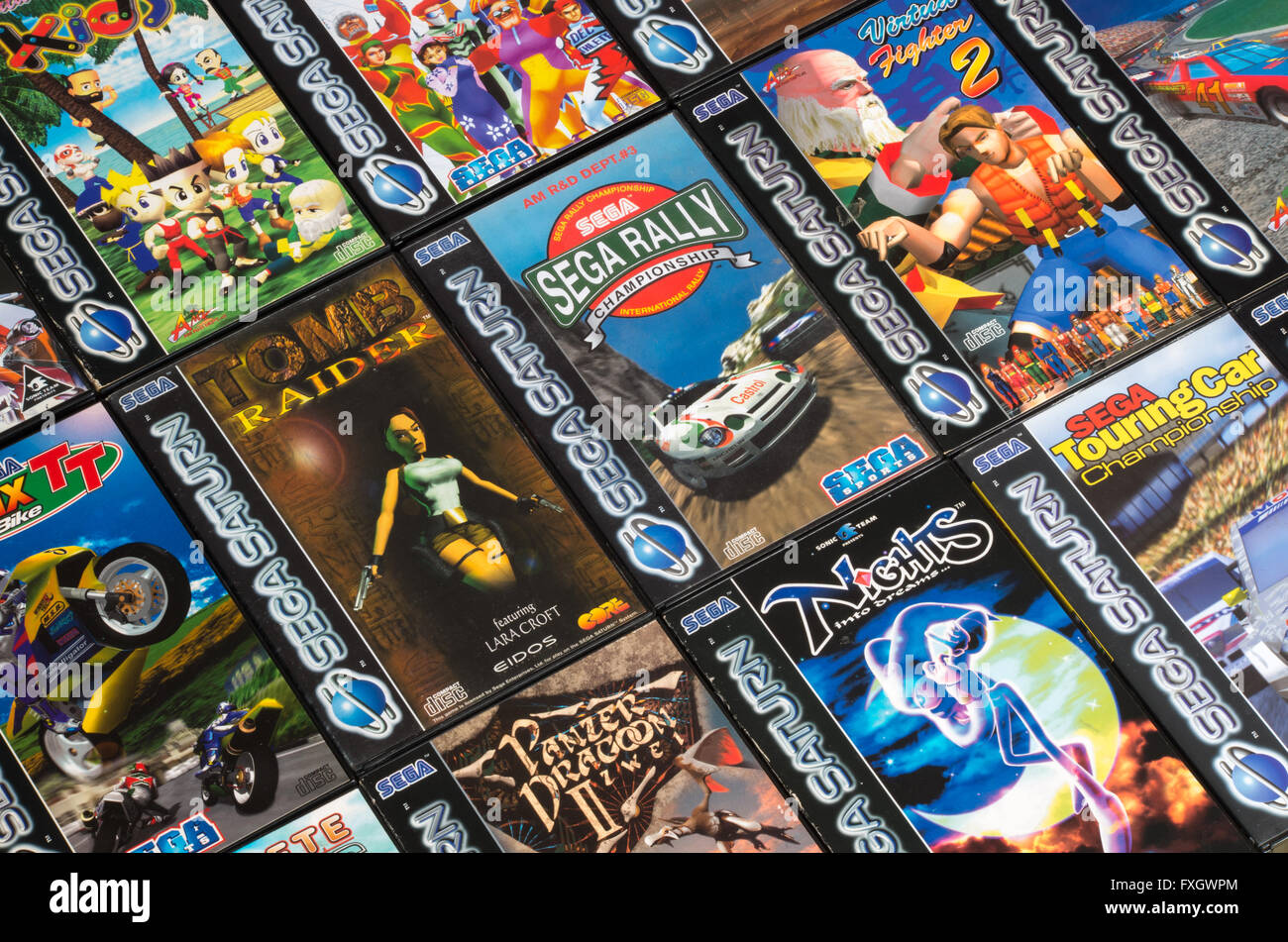 PAL Sega Saturn games laid out in a grid, including Sega Rally Championship, Virtua Fighter 2, Tomb Raider + NiGHTS - Stock Image