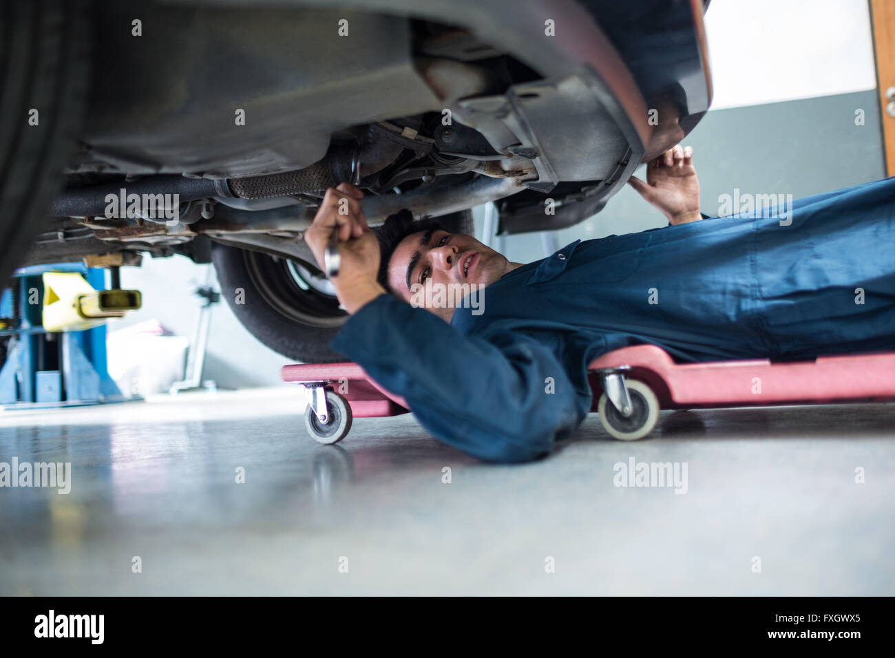 Mechanic repairing a car - Stock Image