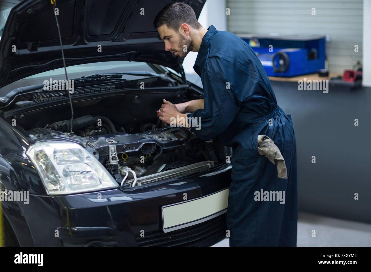 Mechanic examining car engine - Stock Image