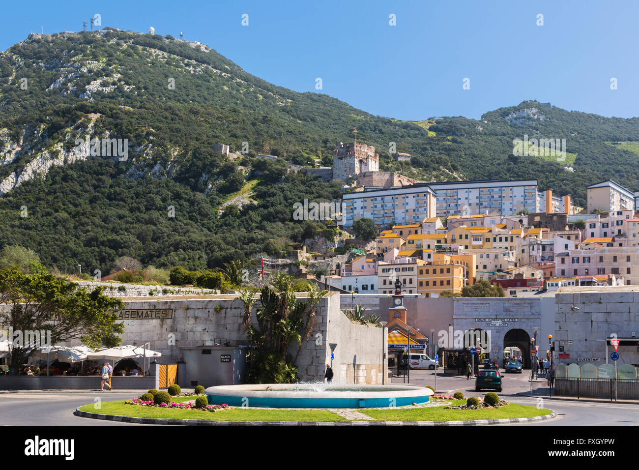 Gibraltar.  The Tower of Homage of the Moorish castle rising behind apartment blocks of Gibraltar town and  Grand - Stock Image
