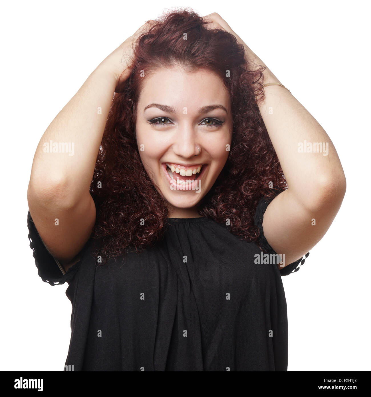 excited girl beaming with delight - Stock Image