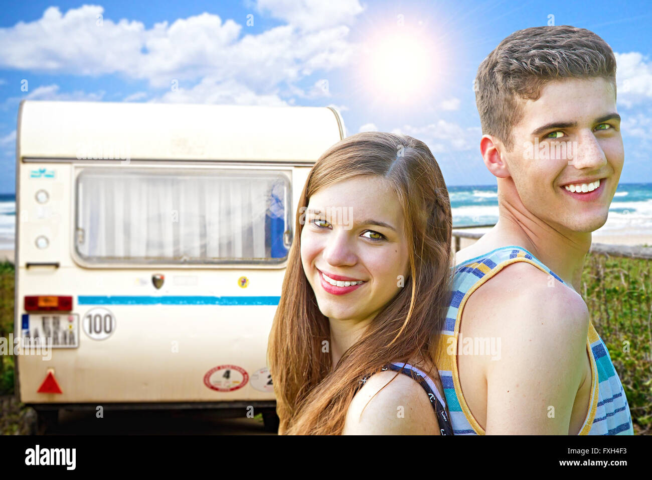 Young couple traveling with camper Stock Photo
