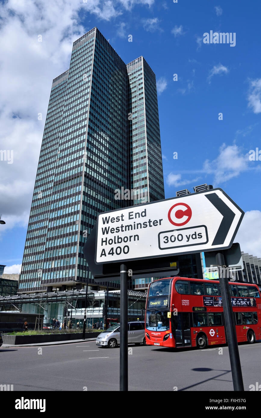 Traffic direction sign with congestion charge symbol, bus and EustonTower in background, Euston Road, Central London, - Stock Image