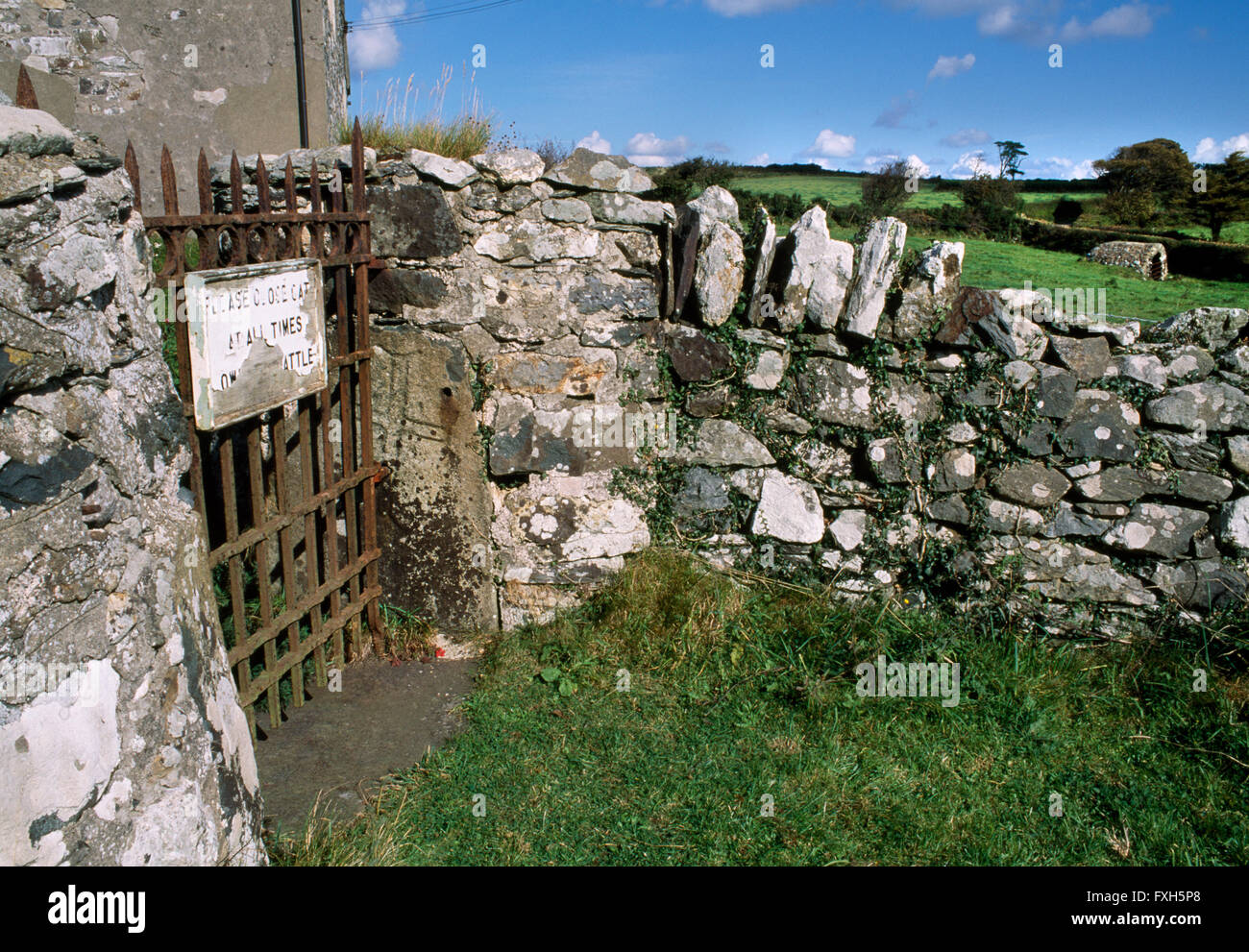 An C8th cross-inscribed stone reused as a gatepost at Llanllawer church in the Gwaun Valley SE of Fishguard, Pembrokeshire. - Stock Image