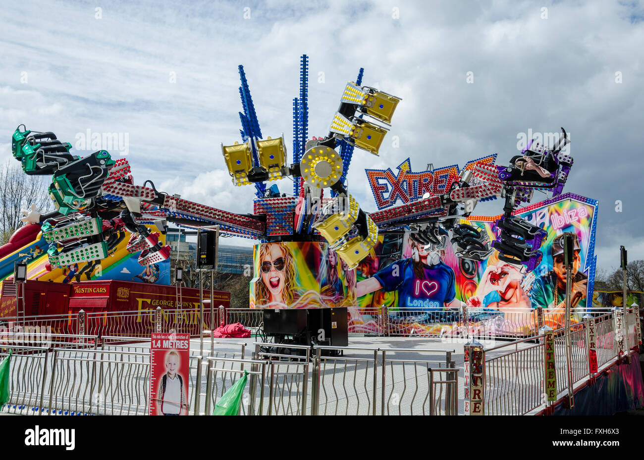 An orbiter ride at a fairground on Shepherds Bush Green in London, England. - Stock Image